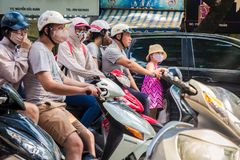 Drivers and girl in pink dress have smog masks to protect from a royalty free stock photos