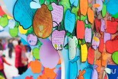 Hanoi, Vietnam - Feb 7, 2015: Children`s promises writen on papers hanging on tree at Vietnamese lunar new year festival organize. D at Vinschool, Vinhomes Times Stock Images