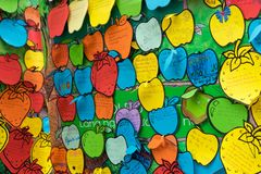 Hanoi, Vietnam - Feb 7, 2015: Children`s promises writen on papers hanging on tree at Vietnamese lunar new year festival organize. D at Vinschool, Vinhomes Times Royalty Free Stock Photography