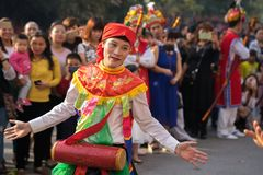 Hanoi, Vietnam - Feb 5, 2017: Men with women dress performing ancient dance called Con Di Danh Bong - Prostitutes beat the drum at. Spring festival in Trieu royalty free stock image