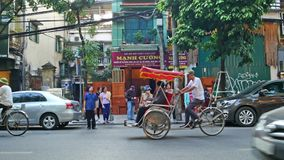 Scenic view of busy traffic in Hanoi Old Quarter with trishaw, motorbikes and vehicles. stock footage