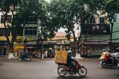 people riding motorbikes on road in Hanoi, Vietnam Royalty Free Stock Photos