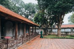 person walking near traditional ancient building in Hanoi, Vietnam Royalty Free Stock Images