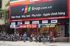 HANOI, VIETNAM - JUL 12, 2014: Front view of a mobile phone store of FPT Telecom in Hanoi capital. FPT is one of the biggest techn. Ology groups in Vietnam Royalty Free Stock Photo