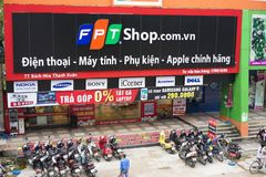 HANOI, VIETNAM - JUL 12, 2014: Front view of a mobile phone store of FPT Telecom in Hanoi capital. FPT is one of the biggest techn. Ology groups in Vietnam Royalty Free Stock Photography