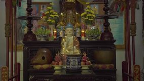 Hanoi, Vietnam - july, 2018: Buddha statue of a Buddhist temple. Gifts and gifts near Buddha statue in pagoda. Asian stock video footage