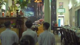 Hanoi, Vietnam - july, 2018: Buddhist monks praying in Buddhist pagoda. Religious monks during prayer in sacred Buddhist. Temple stock footage