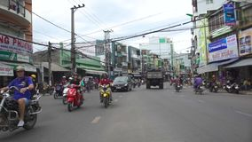 Hanoi, Vietnam - july, 2018: Cars and motorcycles moving asian city street. Road traffic in modern asian city.