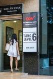 Hanoi, Vietnam - July 7, 2017: GV Cinemas sign at Vincom center Ba Trieu building, with people walking into the building.  Stock Photo