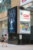 Hanoi, Vietnam - July 7, 2017: GV Cinemas sign at Vincom center Ba Trieu building, with people walking on sidewalk.  Stock Photography