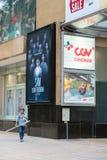 Hanoi, Vietnam - July 7, 2017: GV Cinemas sign at Vincom center Ba Trieu building, with people walking on sidewalk.  Royalty Free Stock Photos