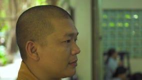 Hanoi, Vietnam - july, 2018: Portrait buddhist monks praying Buddhist pagoda. Close up face man monk in Buddhist temple.