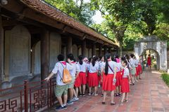 Hanoi, Vietnam - July 24, 2016: Vietnamese pupils visit Temple of Literature, the first national university in Hanoi, Vietnam royalty free stock photo