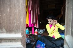 Hanoi, Vietnam - Jun 22, 2017: Actress making up before a traditional operetta in communal house at So village, Quoc Oai district. royalty free stock images