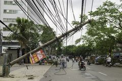 Hanoi, Vietnam - June 14, 2015: Fallen electric pole damaged on street by natural heavy wind storm in Kim Nguu street.  Royalty Free Stock Photo
