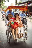 Hanoi, Vietnam, June 21 2015: Life in vietnam- Cyclo beside Swor Royalty Free Stock Image
