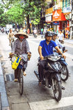 HANOI, VIETNAM, JUNE 15, 2015: People waiting at the traffic lig Stock Photos
