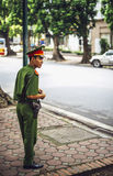 HANOI, VIETNAM - JUNE 14: police officer in the street, in June Royalty Free Stock Images