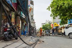 Hanoi, Vietnam - June 14, 2015: Workers fix damaged telecommunication cables after super heavy wind storm in Truong Dinh street. T. His is the heaviest wind Royalty Free Stock Image