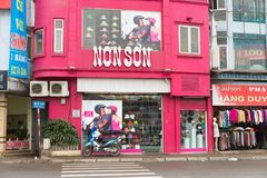 Hanoi, Vietnam - Mar 15, 2015: Exterior facade view of Non Son shop. Non Son is famous brand name of high quality motorcycle helme. T, male and female fashion Stock Photos