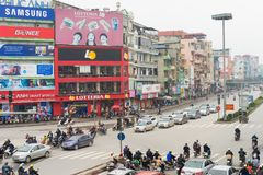 Hanoi, Vietnam - Mar 15, 2015: Low aerial view of Hanoi traffic in Xa Dan street. Vehicles stopping at traffic light royalty free stock photography