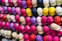 Hanoi, Vietnam - Mar 15, 2015: Many color motorcycle helmets on sale on Chua Boc street. Poor quality helmet is serious problem in. Vietnam royalty free stock photo