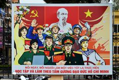 Hanoi Vietnam - Marrz 1, 2015: In front of propaganda billboards Royalty Free Stock Photo