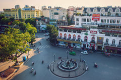 Hanoi,Vietnam - 09 May,2014: People go in the street in sunny afternoon day at Hoan Kiem lake Royalty Free Stock Photography