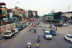 HANOI, VIETNAM - MAY 24, 2017: People on motorbikes on the Hanoi stock photo