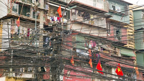 HANOI, VIETNAM - MAY 2014:  Slums with messy electric cables Stock Photography