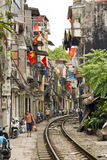 HANOI, VIETNAM - MAY 2014: train passing through slums Stock Photo
