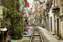 HANOI, VIETNAM - MAY 2014: train passing through slums Royalty Free Stock Photo