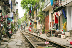 HANOI, VIETNAM - MAY 2014: train passing through slums Royalty Free Stock Image
