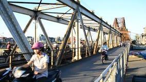 Hanoi Vietnam. Moped Traffic on Train Trestle in Downtown Hanoi Daytime - Hanoi Vietnam stock footage