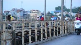 Hanoi Vietnam. Mopeds Crossing a Train Bridge Daytime - Hanoi Vietnam stock video footage
