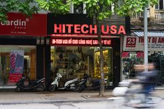Hanoi, Vietnam - Nov 16, 2014: Front view of electronic store in Hang Bai street. Vietnam become potential high technology product Stock Photo