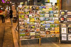 Hanoi, Vietnam - Nov 2, 2014: Photo prints and map on racks of a small mobile shop for selling to tourist on Ma May street, old qu. Arter of Hanoi stock photos