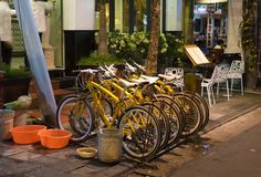 Hanoi, Vietnam - Nov 2, 2014: Row of bikes for rent on Ma May street at night, old quarter of Hanoi Stock Images