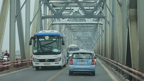 HANOI VIETNAM - NOV6,2017 : traffic on cau chuong duong bridge crossing red river in heart of hanoi township. HANOI VIETNAM - NOV6,2017 :  traffic on  cau chuong stock video footage