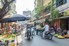 Busy local daily life of the morning street market in Hanoi, Vietnam. A busy crowd of sellers and buyers in the market. Hanoi,Vietnam - November 2,2017 : Busy Royalty Free Stock Images