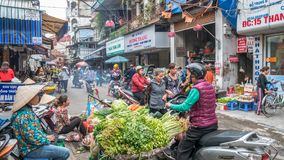 Busy local daily life of the morning street market in Hanoi, Vietnam. A busy crowd of sellers and buyers in the market. Hanoi,Vietnam - November 6 ,2017 : Busy Stock Image