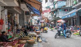 Busy local daily life of the morning street market in Hanoi, Vietnam. A busy crowd of sellers and buyers in the market. Hanoi,Vietnam - November 6,2017 : Busy Royalty Free Stock Images
