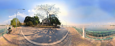Hanoi,Vietnam -November 10,2012: The shadows of the tree is on the street at West lake Stock Photos
