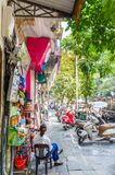Street view of the Hanoi Old Quarter, women can seen chit chatting outside the store. Hanoi,Vietnam - November 2,2017 : Street view of the Hanoi Old Quarter royalty free stock photos