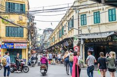 View of busy traffic in an intersection with many motorbikes and people in Hanoi Old Quarter, capital of Vietnam. Royalty Free Stock Photography