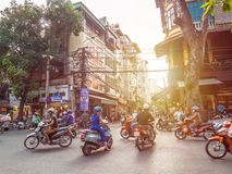 View of busy traffic with motorbikes in Hanoi Old Quarter, capital of Vietnam. Royalty Free Stock Image