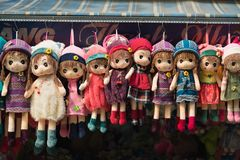 Hanoi, Vietnam - Oct 25, 2015: Cloth dolls for sale on Hang Ma street. The street  is famous for selling toys, paper goods and in. Particular paper votive Stock Photography