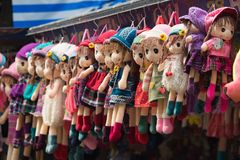 Hanoi, Vietnam - Oct 25, 2015: Cloth dolls for sale on Hang Ma street. The street  is famous for selling toys, paper goods and in. Particular paper votive Royalty Free Stock Images