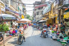 Busy local daily life of the morning street market in Hanoi, Vietnam. A busy crowd of sellers and buyers in the market. Hanoi,Vietnam - October 31,2017 : Busy Stock Images