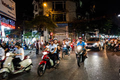 HANOI, VIETNAM, - OCTOBER 10, 2016: Busy motorbike traffic in th. E Old Quarter Royalty Free Stock Photography